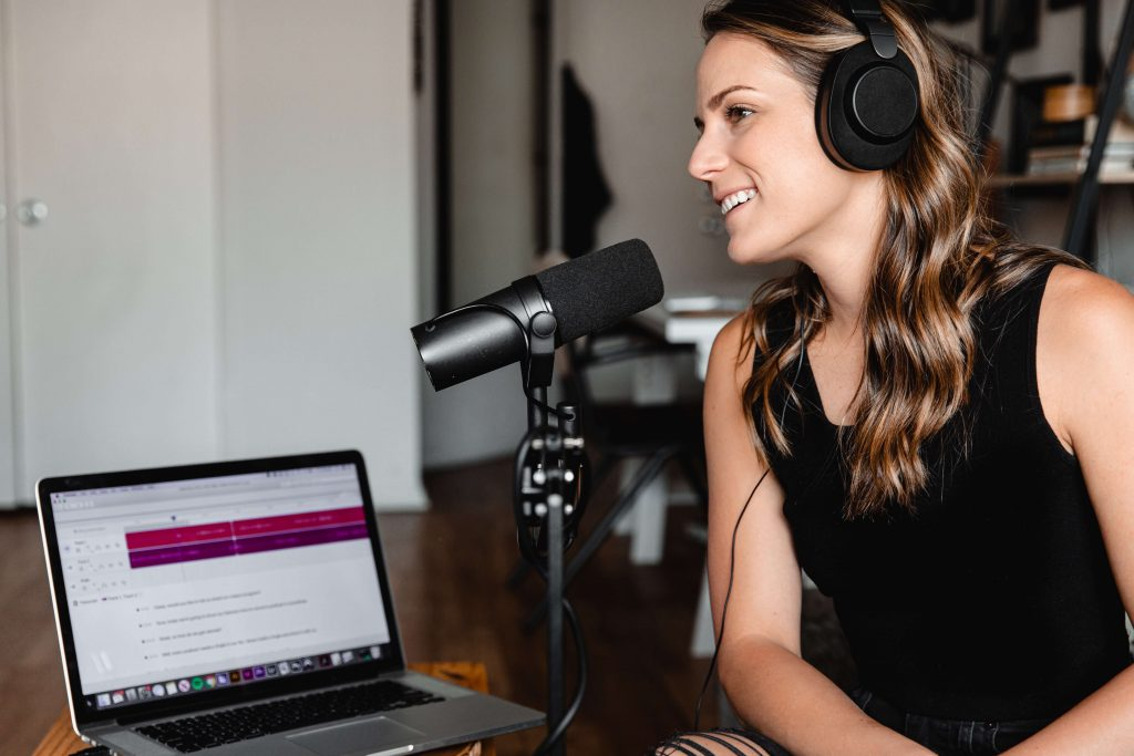 woman podcasting benefits of podcasts